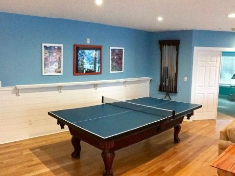 room with blue and white walls and ping pong table
